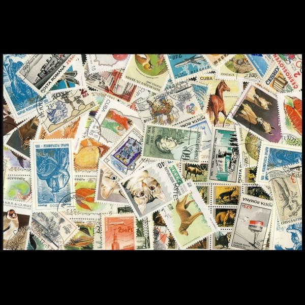 100 sellos matasellados diferentes de todo el mundo.             (Ref.021)