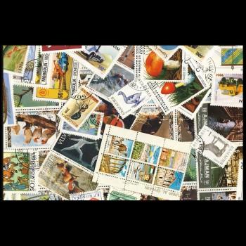 100 sellos matasellados diferentes de todo el mundo.             (Ref.050)