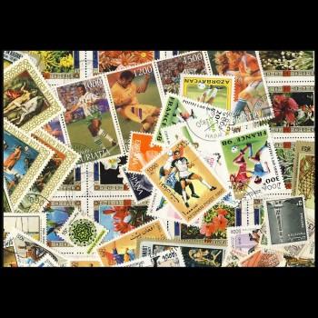 100 sellos matasellados diferentes de todo el mundo.             (Ref.051)